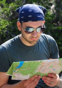 Hiker reading trail map