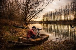 nature photographer in swamp