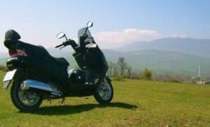 parked motor bike on grassland