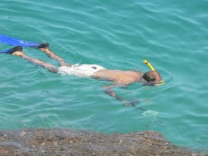 guy snorkeling and spearfishing