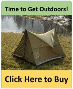 green pup tent by lake