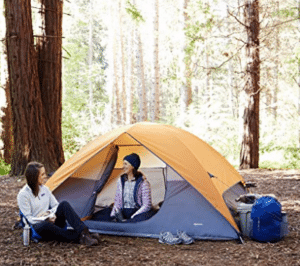 two women talking at camping tent