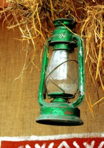 green gas lantern in barn