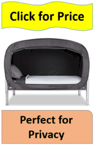 private black bed tent on bed