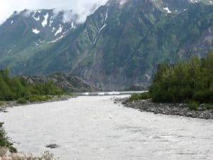 glacier river under Alaska mountain