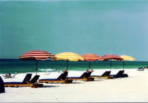 line five beach umbrellas over chairs