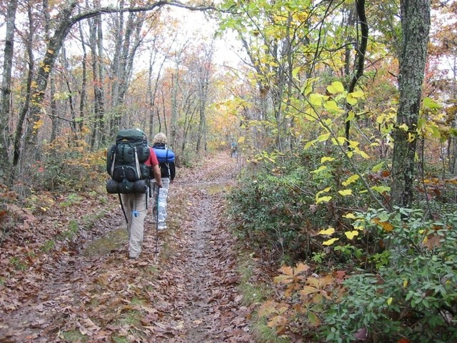 two trail hikers in autumn
