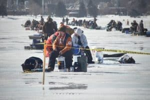 dozens ice fishing on lake