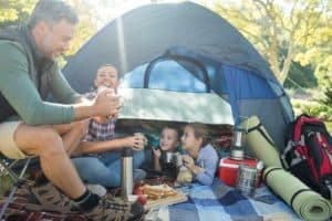 Family hanging out in tent