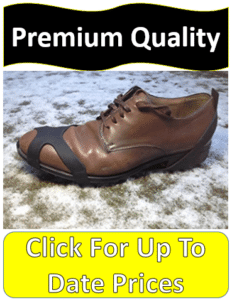 brown shoe with crampon on snowy grass