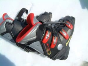 pair of black red gray ski boots