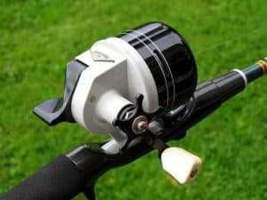 white and black closed face spinning reel