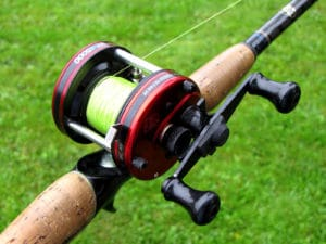 baitcasting reel spooled over grass