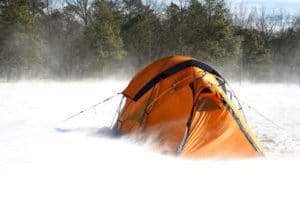 orange tent battered in snow storm