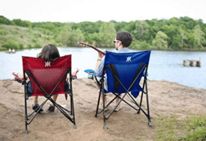 couple sitting by the lake camping chairs