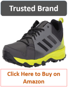 gray adidas hiking shoe with green trim