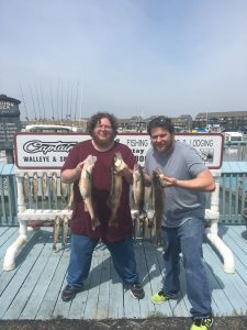 two guys holding walleye