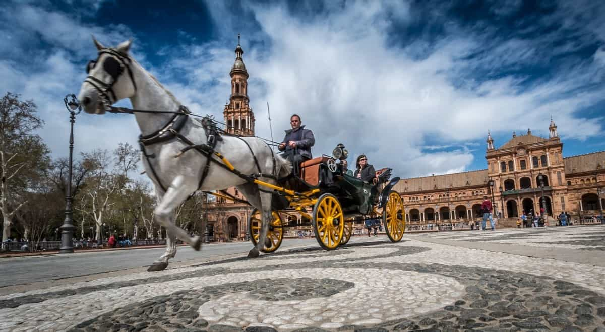 Two passengers in horse drawn carriage Seville Spain