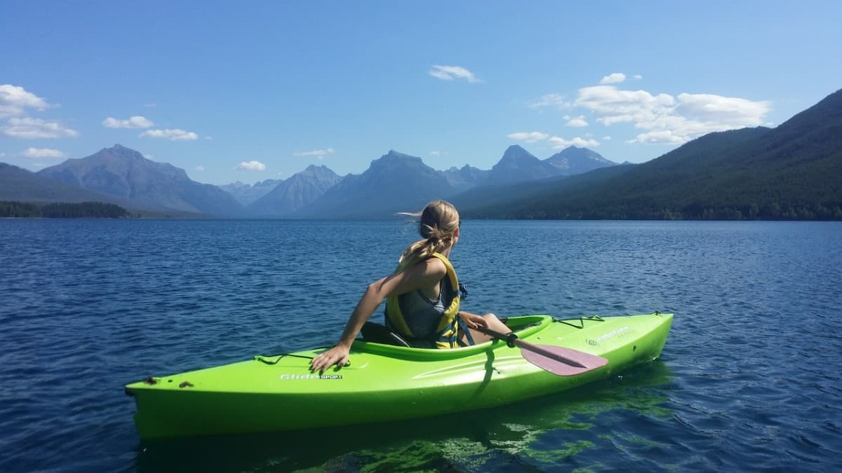 girl kayaking sunny day