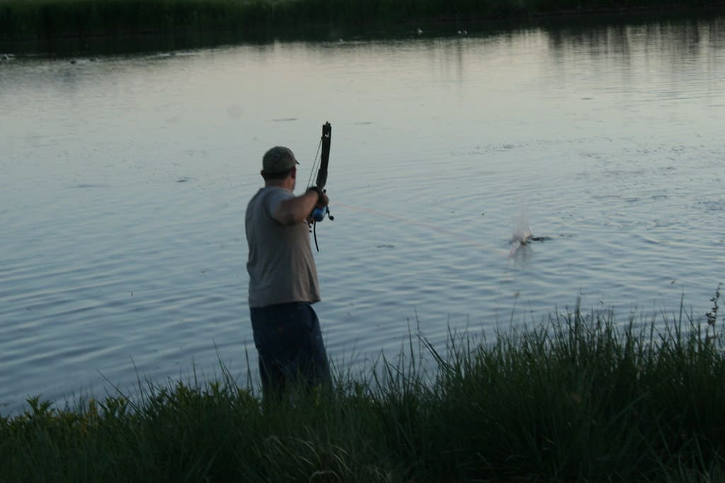 Bow fishing in the evening