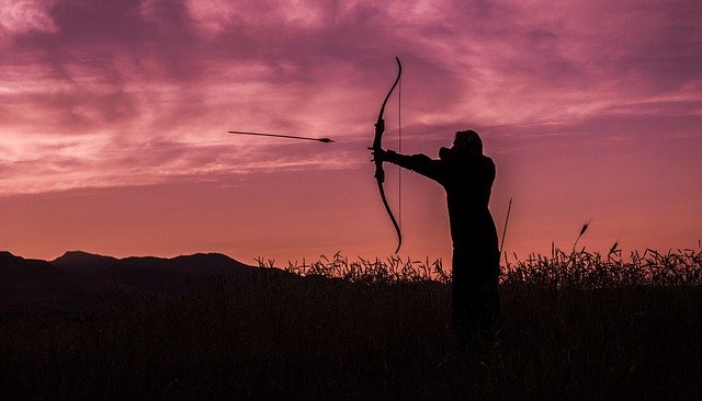 bow hunter in evening