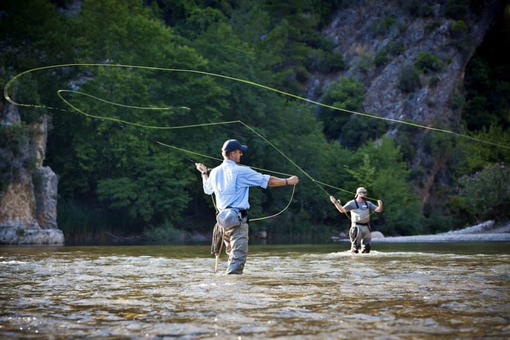 two men fly fishing trout stream